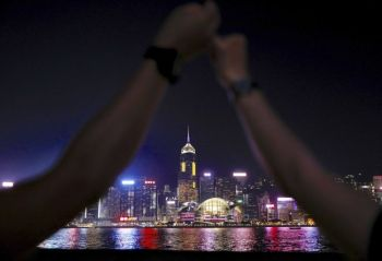 HONG KONG. Demonstrators link hands as they gather at the Tsim Sha Tsui waterfront in Hong Kong, Friday, August 23, 2019. Supporters of Hong Kong's pro-democracy movement are linking hands across the semi-autonomous Chinese territory, inspired by a historic protest 30 years ago in the Baltic states when nearly 2 million people formed a human chain to protest Soviet control. (AP)