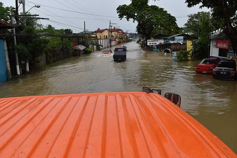 ILOCOS. Severe Tropical Storm Ineng (Bailu) dumped heavy rains that flooded more than 100 barangays in Ilocos Norte. This was in Laoag City. (Photo from City of Laoag Facebook)