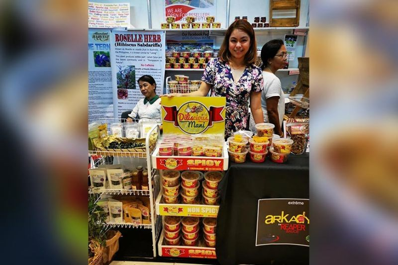 Diliscious Mani owner Geno Mari Branzuela during one of the bazaars and exhibits in the city (Photo courtesy of Geno Mari Branzuela)