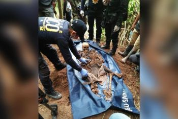 BUKIDNON. Military and police authorities exhume three skeletal remains on August 23 in Kitaotao, Bukidnon. The remains belonged to retired policeman Joel Rey Miqu Galendez, Army Sergeant Reynante Havana Espana, and Indigenous People leader Datu Dionisio Camarullo Havana, who were all abducted in August 2017. (Eastmincom photo)