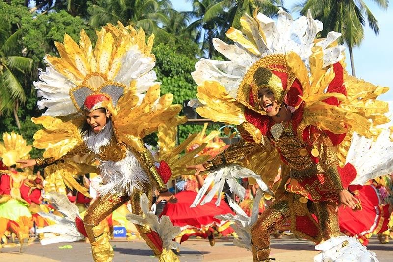 CHEERS. Street dancers perform during Sunday's Higalaay Parade. Barangay Macabalan wins this year's event. (Jo Ann Sablad)
