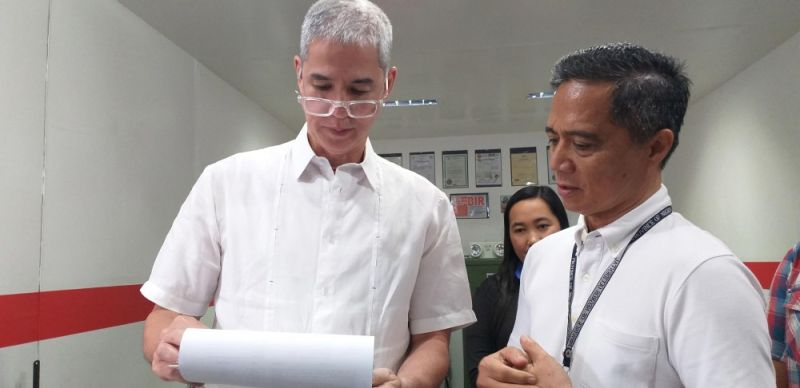 BACOLOD. Negros Occidental Governor Eugenio Jose Lacson (left) and Provincial Veterinarian Renante Decena check the documents of a meat storage facility in Bacolod City during the spot inspection conducted by the Provincial Task Force on African Swine Fever last week. (Photo by Erwin P. Nicavera)