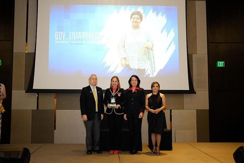 """PAMPANGA.  Board Member Fritzie David-Dizon, on behalf of former governor and now Vice-Governor Lilia """"Nanay"""" Pineda, receives the Development Tourism Award from officers of SKAL Makati. (Contributed photo)"""