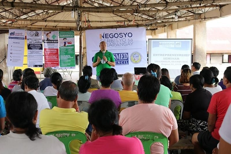 "NEGROS. DTI-Negros Occidental Senior Trade and Industry Development specialist Engiemar Tupas (standing) speaks before the participants of the ""Negosyo Serbisyo sa Barangay"" at Barangay Pacol in Valladolid town Tuesday, August 27, 2019. Contributed Photo"