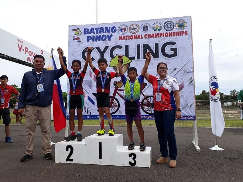 PALAWAN. The boys nine to 11 individual time trial (ITT) medalists including bronze winner Charles Kevin Bacat of Davao City, fourth from left, celebrate their victories during the Batang Pinoy 2019 National Championships cycling competition at the Sta. Monica International Race Track in Puerto Princesa City, Palawan Tuesday, August 27, 2019. (Ruel Casaljay)