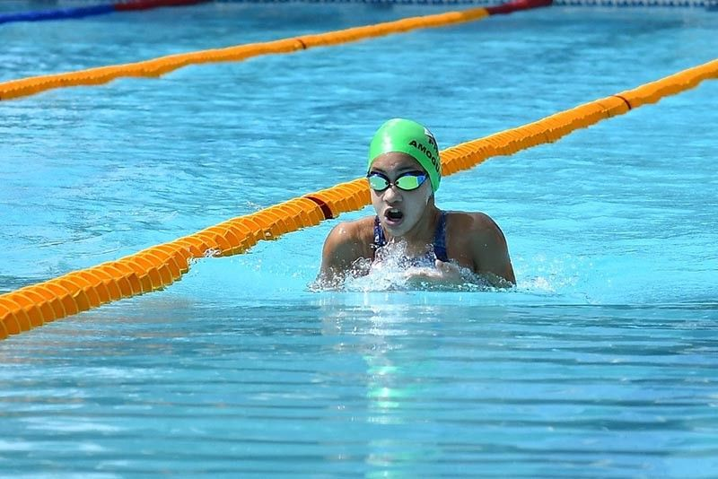 PALAWAN. Dabawenya Liaa Margarette Amoguis, after settling for silver in girls 200-meter individual medley (IM) Monday, recovered yesterday by sealing the girls 400m IM gold at the Ramon V. Mitra Sports Complex in Puerto Princesa City, Palawan. (Skippy Lumawag/SDD-CMO)