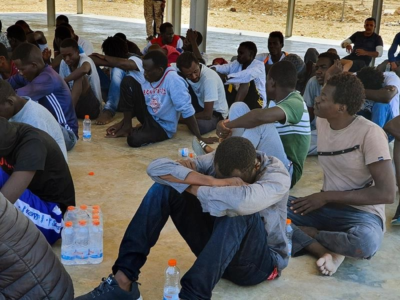 LIBYA. Rescued migrants rest near the city of Khoms, around 120 kilometers (75 miles) east of Tripoli, Libya, Tuesday, August 27, 2019. At least 65 migrants, mostly from Sudan, were rescued, said a spokesman for Libya's coast guard, with a search halted for those still missing. The coast guard gave an estimate for those missing and feared drowned of 15 to 20 people. (AP)