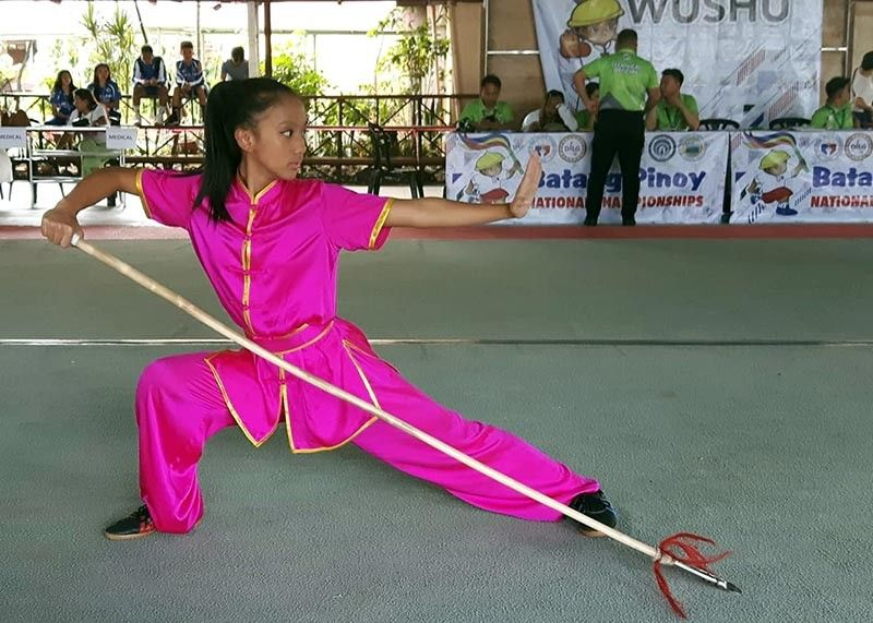 PALAWAN. Aleca Breana Dumseng shows her top form winning the gold medal in the female 1st Set quiang shu/gun shu (Long weapon) with a score of 9.08 to win the gold medal in the ongoing Batang Pinoy 2019 National Finals. (Contributed photo)