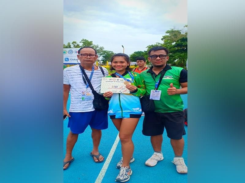 Barangay Balubal pride Rona Bacus with her coaches after winning a bronze for Team CdeO in high jump competition of the ongoing Batang Pinoy Meet in Puerto Princesa, Palawan. (Contributed photo)