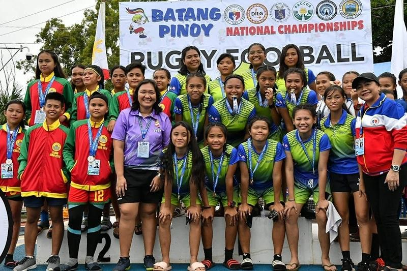 PALAWAN. Davao City's girls rugby football team members receive their gold medals during the awarding ceremony at the Ramon V. Mitra Sports Complex in Puerto Princesa City, Palawan. (Skippy Lumawag/SDD-CMO)
