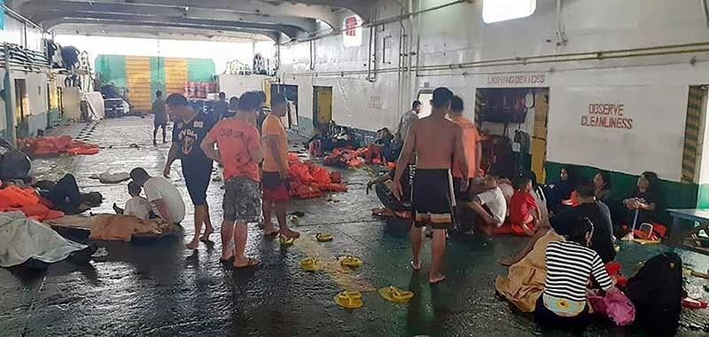 CEBU. In this photo from the Philippine Coast Guard in Manila, PCG rescuers and crew of responding vessels attend to rescued passengers of the ill-fated MV Lite Ferry 16, on a ferry that responded to the distress call. (AP)