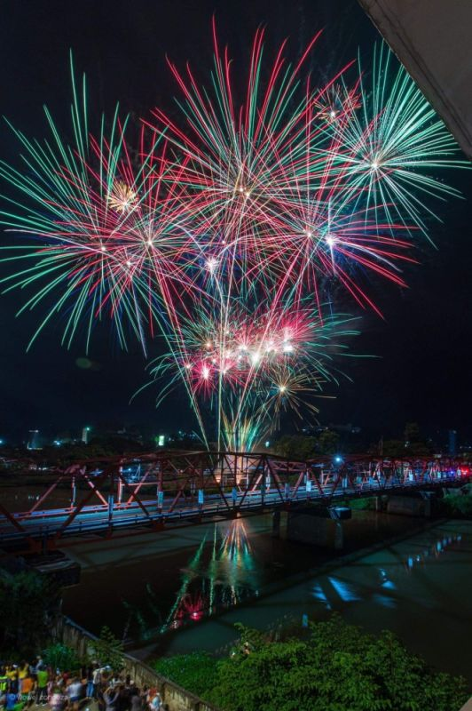CAGAYAN DE ORO. Fireworks are lit Tuesday night, August 27, 2019 partially lighting Cagayan de Oro's historic Ysalina Bridge, as part of the Higalaay Festival which culminates Wednesday, August 28 in time for the Feast of St. Augustine. (Rhoel Condeza/City Information Office)