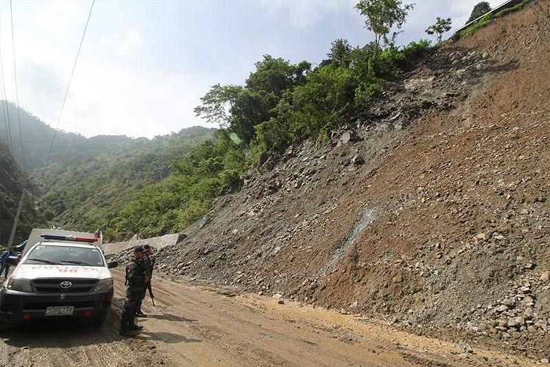 BENGUET. Personnel from the Tuba Municipal Police Station conducts a security check at a landslide prone area at Kennon Road along Camp 5, Tuba Benguet. Due to the current situation of the area, Kennon Road remains closed and is only passable for residents. (Photo by Jean Nicole Cortes)