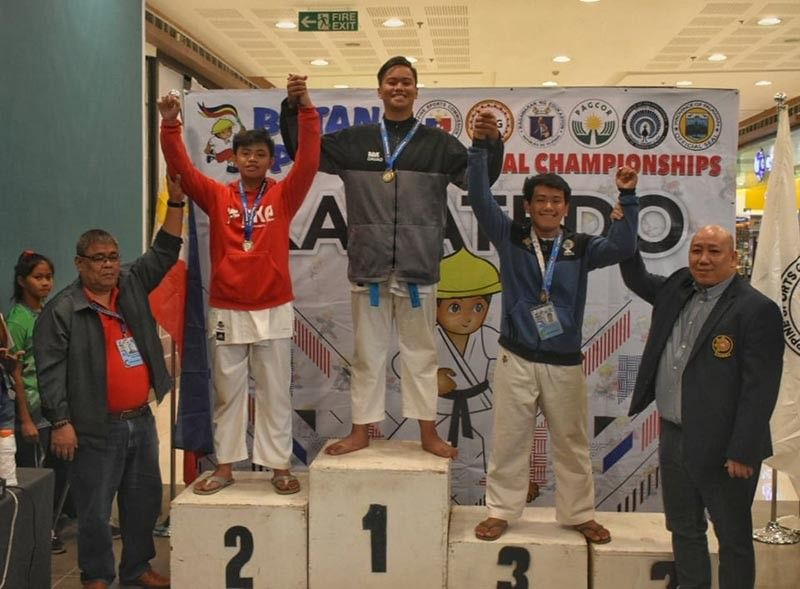 PALAWAN. Kumite boys 14-15 -70 kilograms gold medalist Stephen James Cartagena, center, beams with pride as he and the other medalist receive their medals as the Batang Pinoy 2019 National Championships karatedo competition closed at SM City Puerto Princesa Thursday, August 29, 2019. (Rommel Tan)