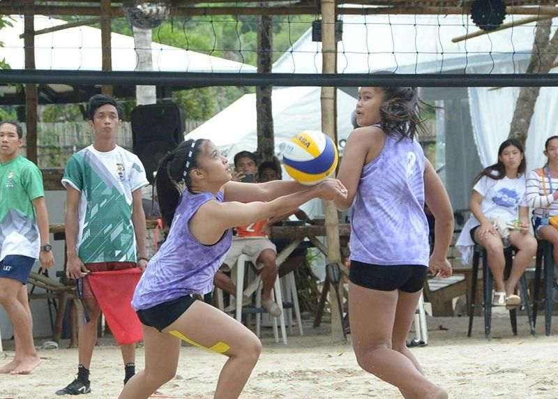 PALAWAN. Khalia Sinsuat, left, receives the ball as teammate April Joy Locaberte watches during their Batang Pinoy 2019 National Championships beach volleyball game against Puerto Princesa City at Blue Palawan beach resort in Puerto Princesa City, Palawan yesterday. (DSA photo)