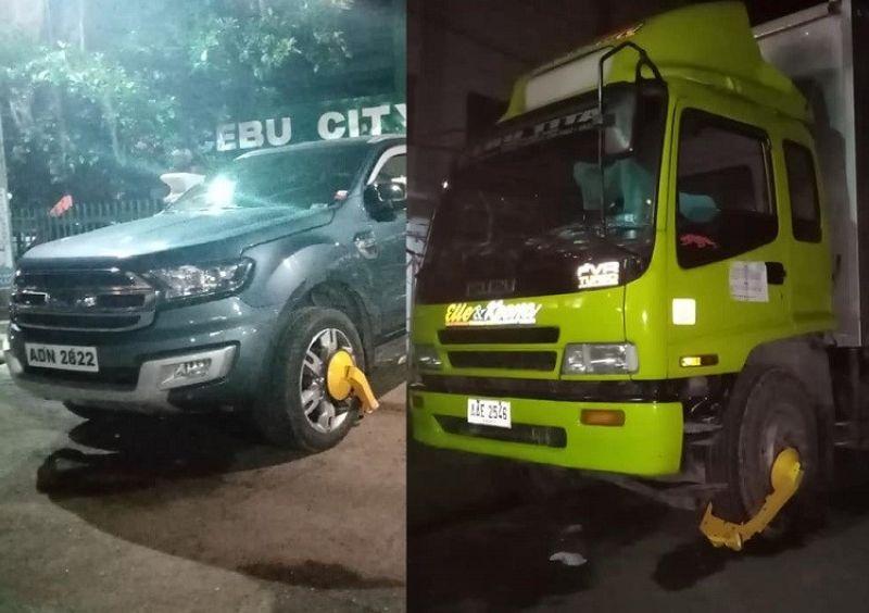 CEBU. Moabot sa 14 ka mga sakyanan nga nag-overnight parking sa dalan ang gipang-clamp sa mga sakop sa Cebu City Traffic Operation  sa Barangay Sawang Calero, Dakbayan sa Sugbo. (Hulagway iya ni Benjie B. Talisic)