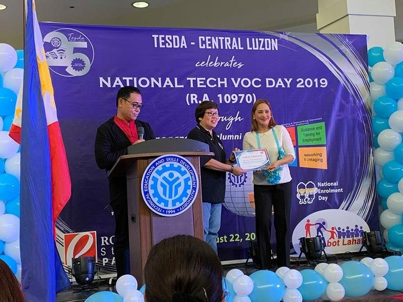 PAMPANGA. Board Member Fritzie David-Dizon receives a certificate from officers of Tesda during Tech-Voc Day in the City of San Fernando. David-Dizon, who represented Gov. Dennis Pineda in the event, assured the Province's support for Tesda initiatives. (Ian Ocampo Flora)