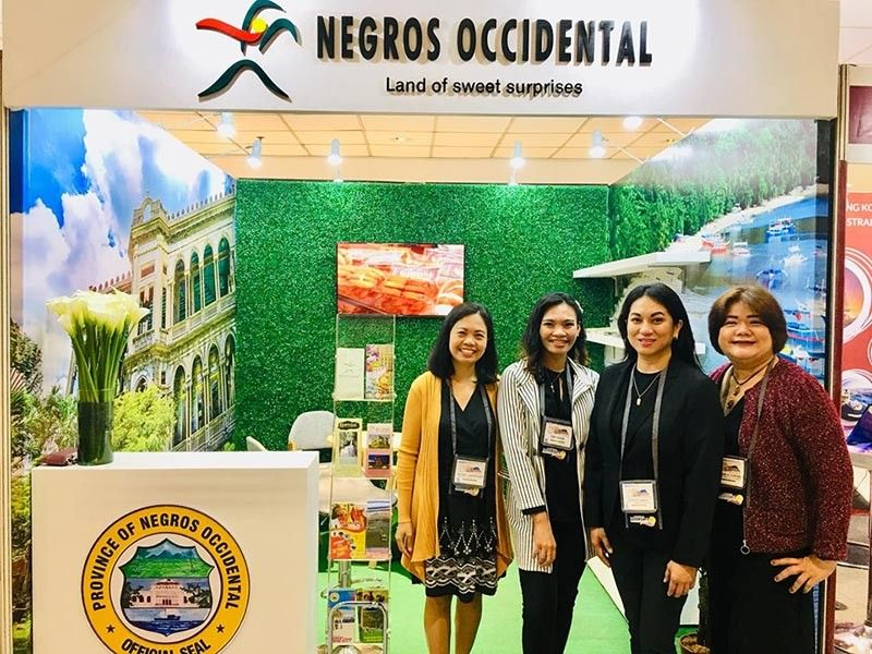MANILA. Negros Occidental Tourism team headed by Provincial Supervising Tourism Operations Officer Cristine Mansinares (left) at the Negros Occidental booth at the ongoing 30th Philippine Travel Mart at the SMX Convention Center at Mall of Asia Complex in Pasay City from August 30 to September 1, 2019. (Contributed Photo)