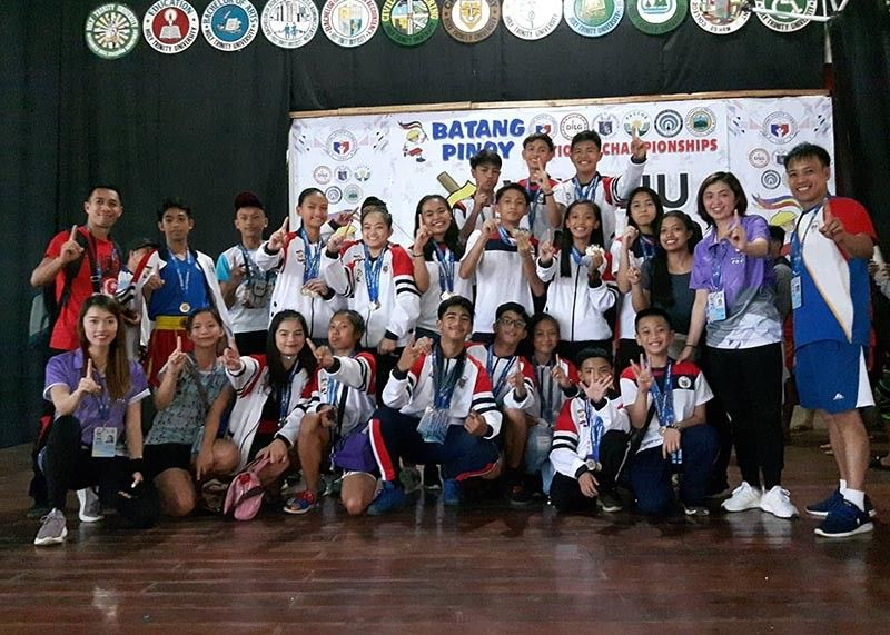 PALAWAN. Members of the Baguio wushu taulo squad flash the number one sign after amassing 12 gold medals in the Batang Pinoy National Finals in Puerto Princesa City, Palawan. (Contributed photo)