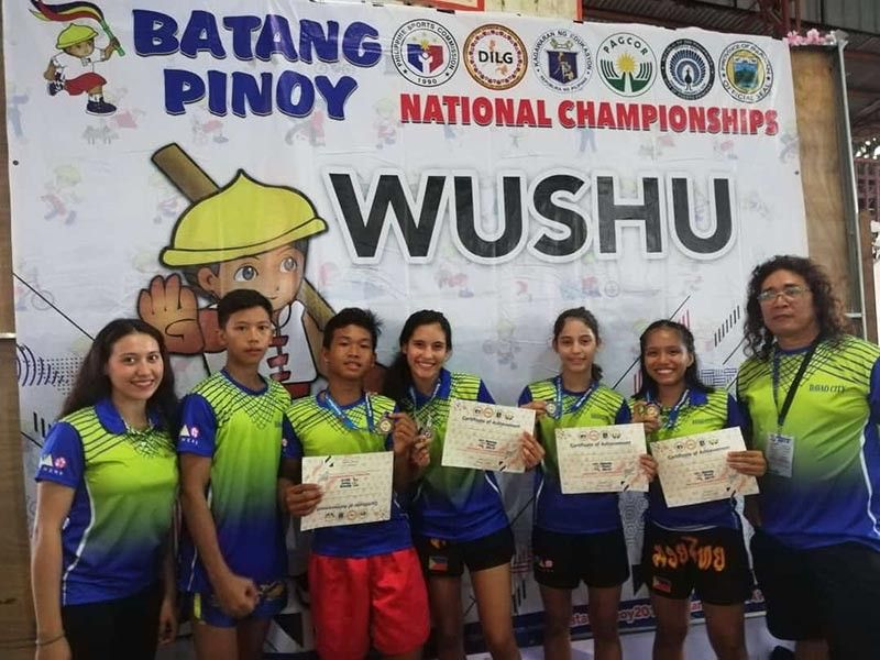 PALAWAN. Davao City medalists and their coaches celebrate during the awarding ceremonies of the Batang Pinoy 2019 National Championships wushu competition at the Holy Trinity University late Thursday afternoon. CATHY ASTUDILLO