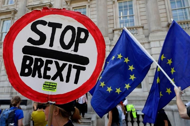 LONDON. Anti-Brexit demonstrators wave banners and flags outside the Cabinet Office in London, Friday, August 30, 2019. A legal challenge aimed at stopping Boris Johnson's suspension of Parliament has been denied an interim interdict at the Court of Session in Edinburgh on Friday. A cross-party group of MPs and peers filed a petition at Scotland's highest civil court earlier this summer aiming to stop the Prime Minister being able to prorogue Parliament. (AP)