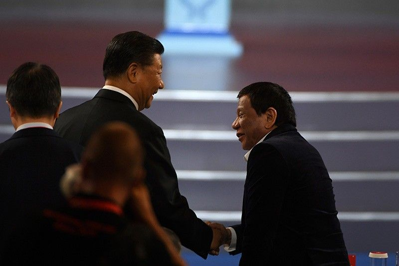 China's President Xi Jinping, left, shakes hands with Philippines President Rodrigo Duterte during the opening ceremony of the 2019 Basketball World Cup in Beijing, China, Friday August 30, 2019. (AP)