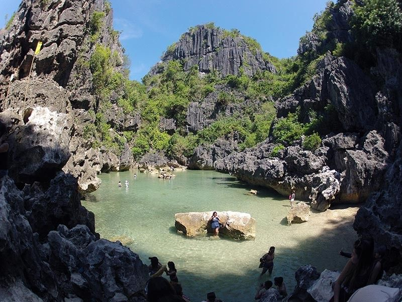 ILOILO. In this file photo, July 22, 2019, tourists take time swimming and taking pictures of the famous saltwater lagoon of Gigantes Island in Iloilo. The lagoon is closed for the month of September as announced by Carles Mayor Seigfredo Betita. (Photo by Leo Solinap)
