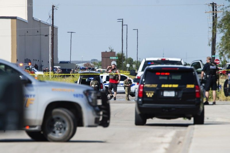 ODESSA, TEXAS. Odessa and Midland police and sheriff's deputies surround the area behind Cinergy in Odessa, Texas, Saturday, August 31, 2019, after reports of shootings. Police said there are