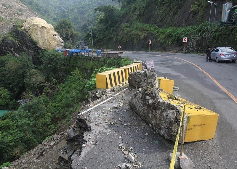 BAGUIO. A road cut near the iconic lion's head in Kennon Road occurred during the continuous monsoon rains as the Department of Public Works and Highways proposed P3 billion funding to make the highway an all-weather road. (Jean Nicole Cortes)