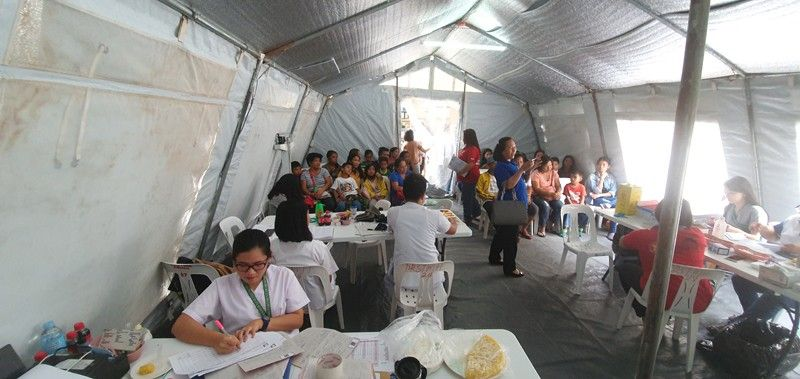 AKLAN. Patients with suspected dengue cases wait for their turn to be treated using the hydration facility set up by the Philippine Red Cross at the Aklan Provincial Hospital. (Photo by: Jun N. Aguirre)
