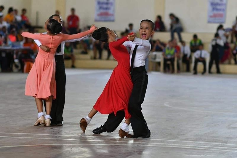 DOUBLE CHAMPS. This photo of dancesports double gold medalists Sam Ashlee Cameros and Precious Hanna Hecale of Davao City won runner-up honors in the Batang Pinoy 2019 National Championships photo contest recently. (Skippy Lumawag/SDD-CMO)