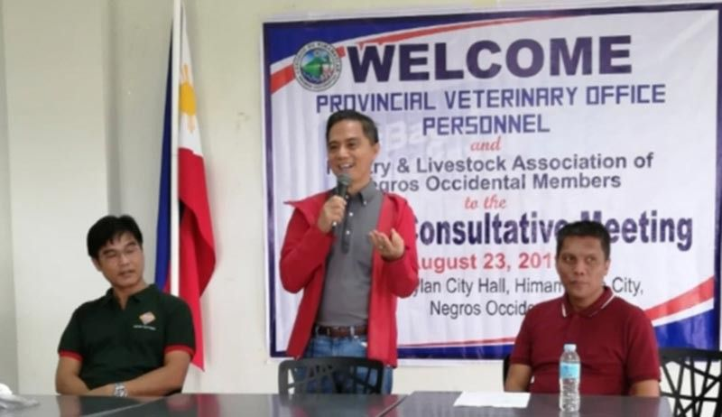 Provincial Veterinarian Renante Decena (center) speaks at the signing of memorandum of collaboration with 10 recipient-local government units of Swine Artificial Insemination and Laboratory Center project in Himamaylan City recently. (Contributed photo)