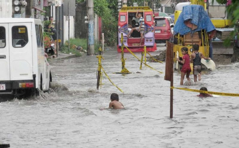 SUNDAY, FLOODY SUNDAY: The heavy downpour Sunday afternoon, Sept. 1, 2019, causes flooding in certain parts of Metro Cebu, much to the delight of children  who suddenly have a makeshift swimming pool right in their backyard.