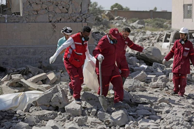 YEMEN. Rescue workers carry a body from under the rubble of a Houthi detention center destroyed by Saudi-led airstrikes, that killed at least 60 people and wounding several dozen according to officials and the rebels' health ministry, in Dhamar province, southwestern Yemen, Sunday, September 1, 2019. The officials said the airstrikes took place Sunday and targeted a college in the city of Dhamar, which the Houthi rebels use as a detention center. The Saudi-led coalition said it had hit a Houthi military facility used as storages for drones and missiles in Dhamar. (AP)