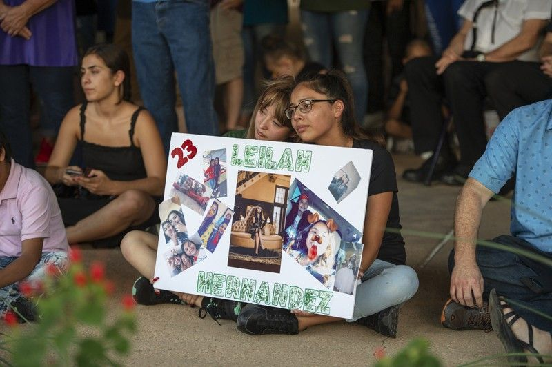 ODESSA, TEXAS. Celeste Lujan (left) and Yasmin Natera hold a sign in honor of Leilah Hernandez during a vigil for victims of the shooting spree the day before, Sunday, September 1, 2019, at the University of Texas of the Permian Basin quad, in Odessa, Texas. (AP)