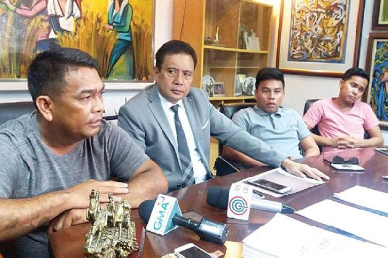CEBU. Atty. Inocencio Dela Cerna (center) with Lobo Boniel (left), one of  his clients in the Boniel case. (SunStar File)