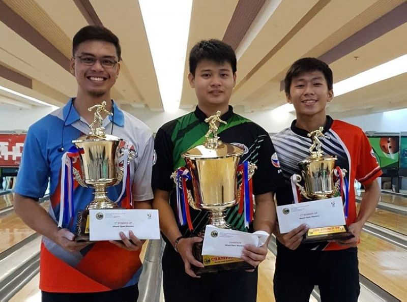 DAVAO. The winners of the 1st Metba-Davao Kadayawan Open Tenpin Bowling Championships Mixed Open Division from left, runner-up Manuel Nierra II of Acbi-Cebu, champion Merwin Tan of RP Team and Joseph