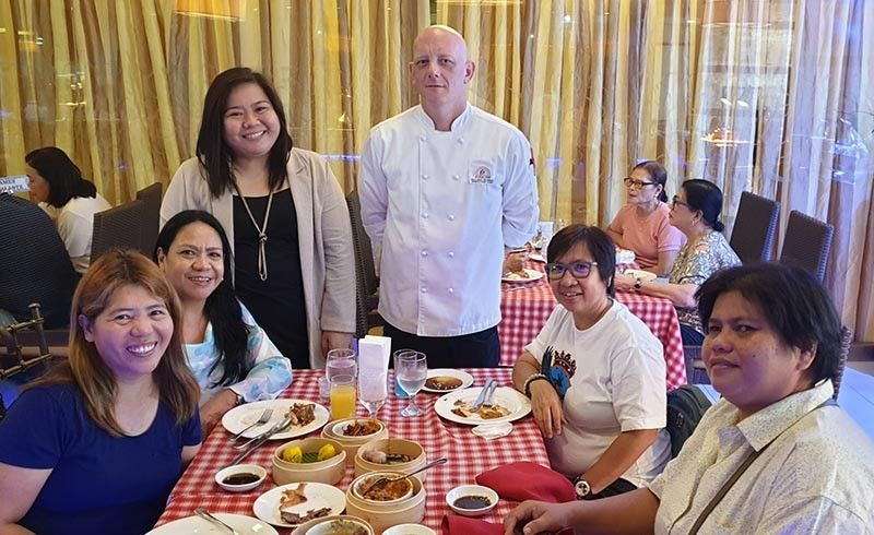 BACOLOD. L'Fisher hotel Executive Chef Allen Alber (2nd from left, standing) and Kristine V. Garcia, Sales & Marketing Manager with some media practitioners in a brunch buffet at the Ripples. (PR)