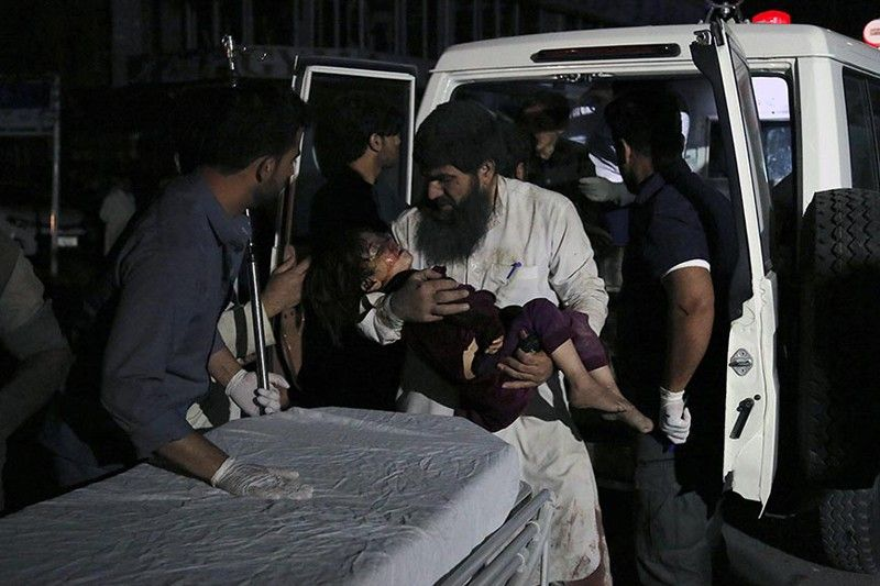 Afghan men carry an injured girl into the hospital after a large explosion in Kabul, Afghanistan, Monday, September 2, 2019. Afghan officials say a large explosion in Kabul has targeted the Green Village compound, home to several international organizations and guesthouses. (AP)