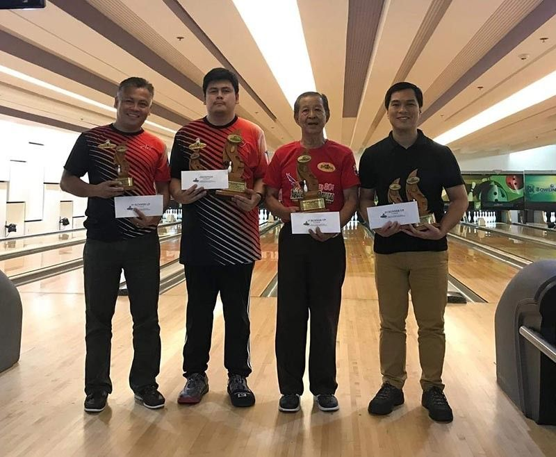 DAVAO. From left, Art Galendez, Arthur John Galendez, Virgilio Magdale and Joshua Disuacido receive their prizes after grabbing the top four spots of the recently-concluded Datba August monthly finals tournament at SM Lanang Premier Bowling Center. (Jesrael Rule)