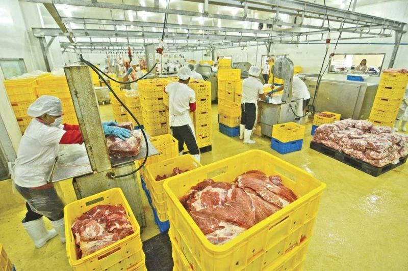 CEBU. In this file photo, pork is being prepared for distribution at the Virginia Farms Inc. facility in Mandaue City, Cebu. (File Photo)