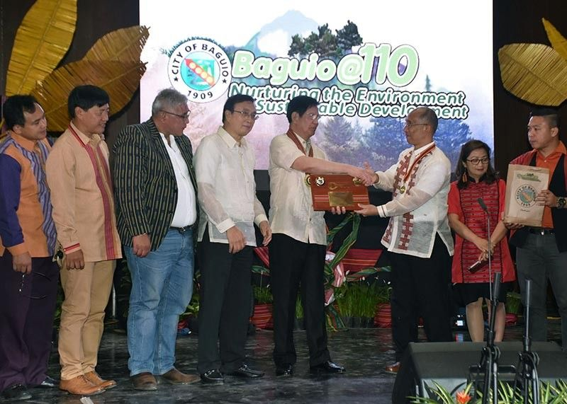 BAGUIO. Senator Panfilo Lacson receives a certificate of appreciation from city officials during the 110th Baguio Charter Day celebration on September 1. (Photo by Redjie Melvic Cawis)