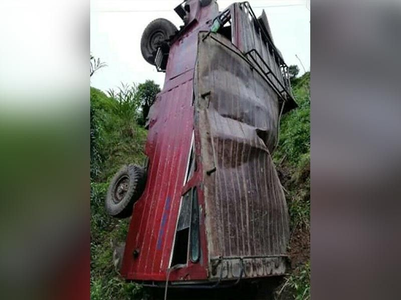 BENGUET. Three escaped death after their jeepney fell off a 100-meter cliff in Sitio Bayoyo, Gambang, Bakun in Benguet. (Photo by Simon Guinid)