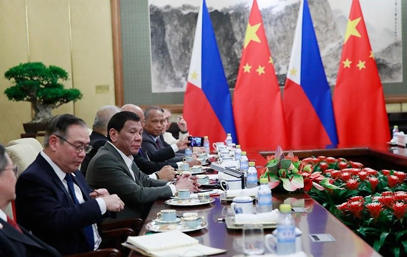 CAPTION: In this file photo, President Rodrigo Duterte, second from left, speaks to Chinese President Xi Jinping (not pictured) during their meeting at the Diaoyutai State Guesthouse in Beijing, Thursday, August 29, 2019. (AP)