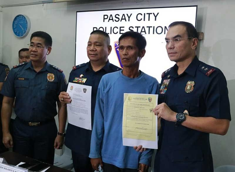 MANILA. Nicanor Naz, who was meted life imprisonment for illegal drugs charges in 1993, surrenders to the Pasay City Police and Major General Guillermo Eleazar (right), director of the National Capital Region Police Office, on September 5, 2019. (Photo from NCRPO)