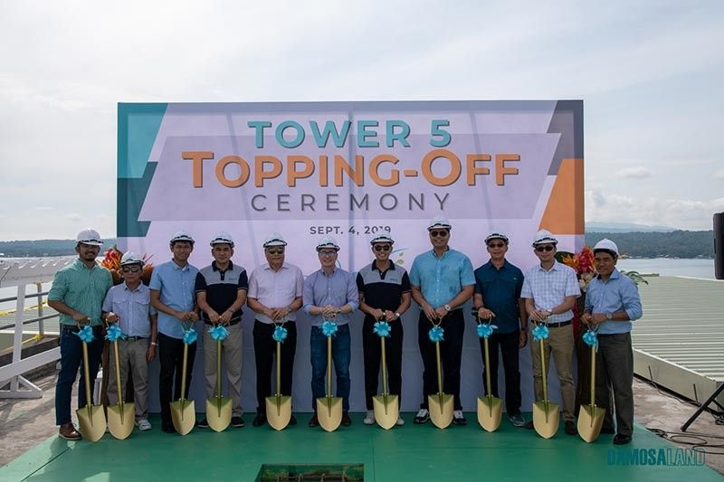 DAVAO. Seawind by Damosa Land, Inc. (DLI) celebrates two milestones on Wednesday, September 4, 2019 -- the blessing of Tower 4 and the topping off for Tower 5. DLI topped off for Tower 4 just last April 2019 with 229 units completed to date. On the other hand, Tower 5 has 214 units built, which is set to be completed in May 2020. (Contributed photo)