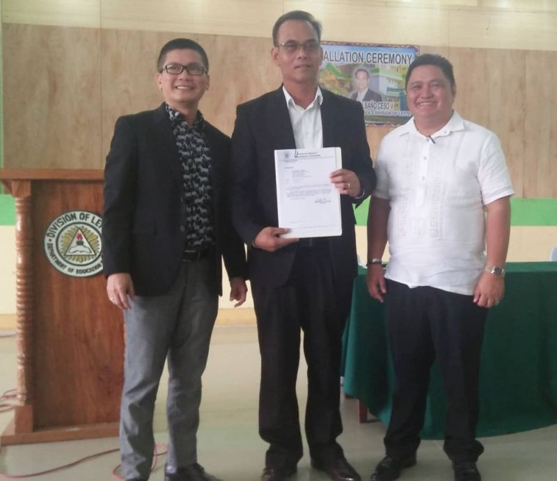 LEYTE. (Left to right) Department of Education Eastern Visayas director Ramir Uytico, new Leyte Schools Division Superintendent Dr. Manuel Albaño, and outgoing Leyte Schools Division Superintendent Ronelo Al Firmo during the installation ceremony at the Leyte Division Gymnasium in Palo, Leyte, September 6, 2019. (Photo courtesy of Melfe Sanchez)
