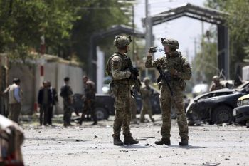 Resolute Support (RS) forces arrive at the site of car bomb explosion in Kabul, Afghanistan, Thursday, Sept. 5, 2019. A car bomb rocked the Afghan capital on Thursday and smoke rose from a part of eastern Kabul near a neighborhood housing the U.S. Embassy, the NATO Resolute Support mission and other diplomatic missions. (AP Photo/Rahmat Gul)