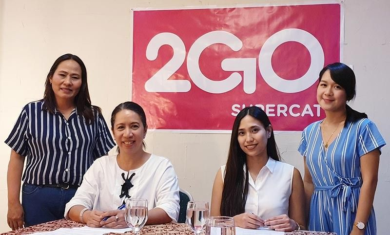 BACOLOD. Representatives of Supercat Fast Ferry Corporation (2GO Supercat) and Lakawon Island Resort and Spa signed a memorandum of agreement to forge a partnership on travel and tourism promotion. In photo are Terrie Bernas-Abad, SFFC head (seated, left) and Nastacia Maria Gonzalez, owner and chief finance officer of Lakawon Island Resort and Spa (seated, right). The MOA signing was witnessed by Maribel D. Avanceña, 2GO Supercat sales manager, Visayas (left) and Michelle Lopez, Lakawon sales and marketing officer (right). (Contributed Photo)