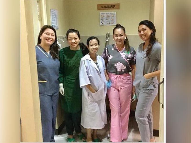 Dr. Luz Acosta-Barrientos (second from right) with her clinic staff. (Photo from Dr. Acosta-Barrientos Facebook)